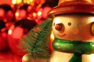 snow man toy with Christmas backgroun