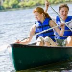 a couple is enjoy a canoe ride