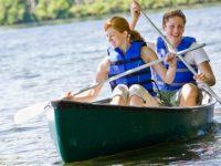 a couple is enjoy a canoe ride