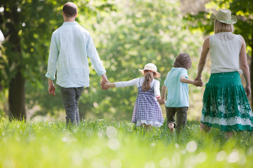 Family strolling in a park