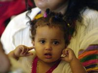 Young girl at New Citizens Celebration, Seattle, Washington, 2000 photo from Seattle Municipal Archives