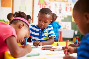 kids coloring together