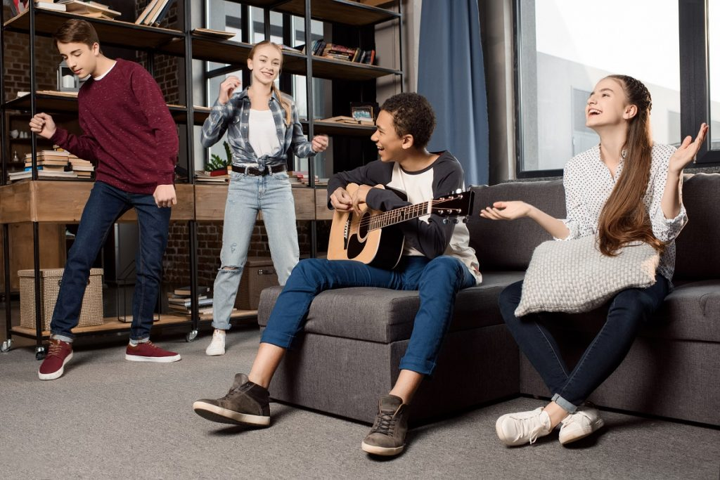 Teens hanging out with music