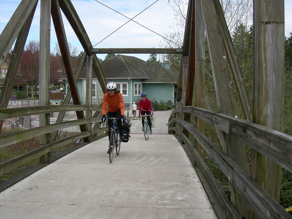 Bicyclists crsssing the bridge at Bothell Landing to the Burke-Gilman Trail photo by Joe Mabel (CC3)