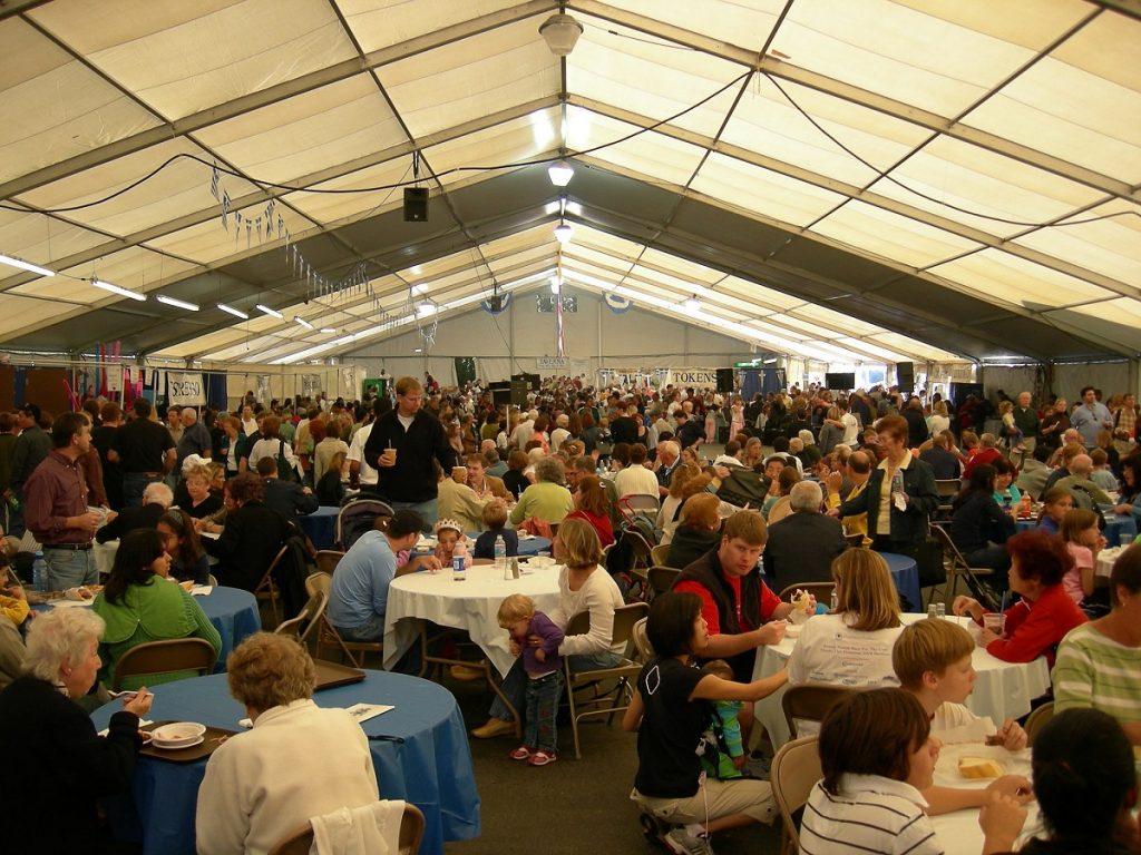 Crowd in pavillion tent, St. Demetrios Greek Festival, Seattle, WA photo by Joe Mabel (CC3)