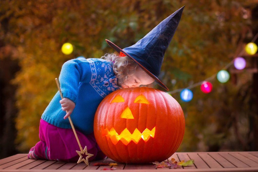 Girl with a Halloween pumpkin