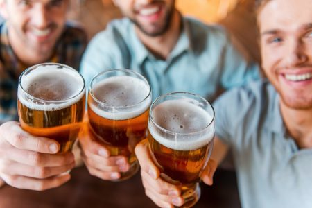 Men toasting with pints of beer