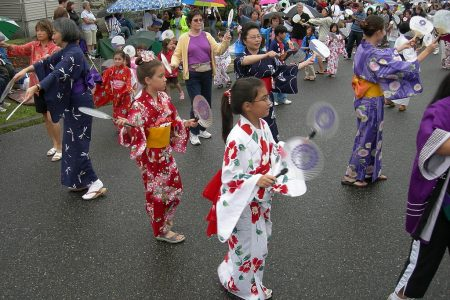 Dancing the Omikoshi Ondo (note the round fans) at Seafair Bon Odori Festival, Seattle, WA photo by Joe Mabel (CC3)