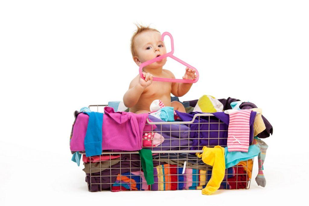 Basket of baby clothes for consignment - DepositPhotos.com