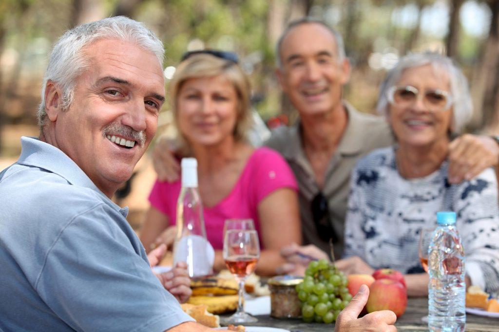 People enjoying an alfresco lunch
