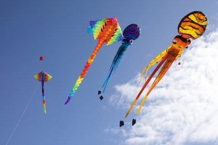 colorful flying kites - DepositPhotos.com