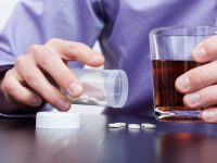 Man drinking alcohol and taking pills photo by photographee.eu - DepositPhotos.com