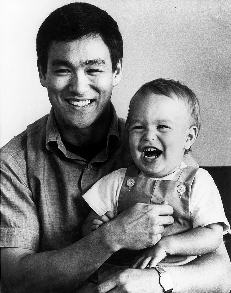 1966 Publicity photo of Bruce Lee with son Brandon. (public domain)
