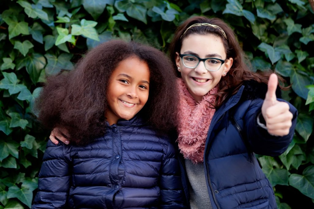 Young girls in winter coats