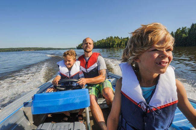 Father and sons out boating together.