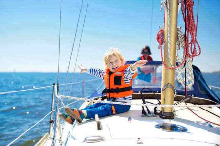 Happy kid on a sailboat