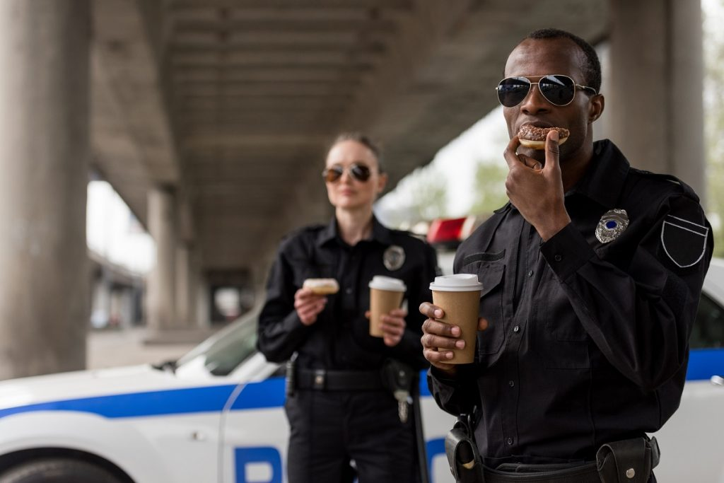 Police officers eating donuts