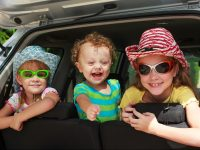 children on a summer famiuly road trip