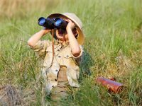 Explorer kid with binoculars