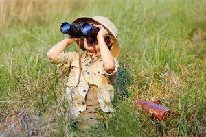 Explorer kid with binoculars