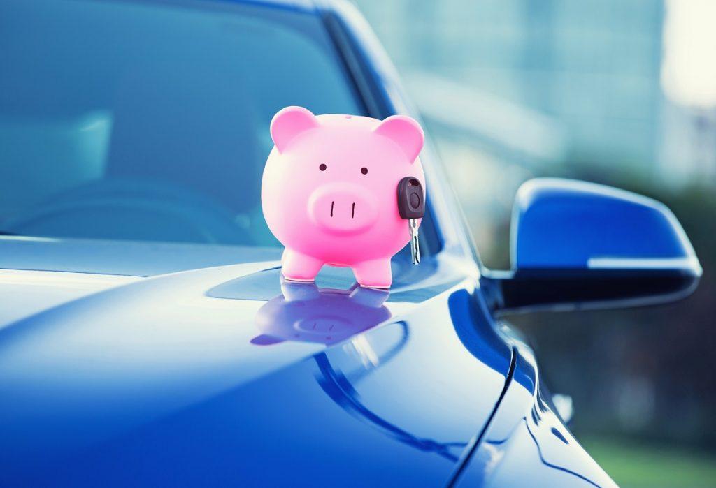 new car key and piggy bank