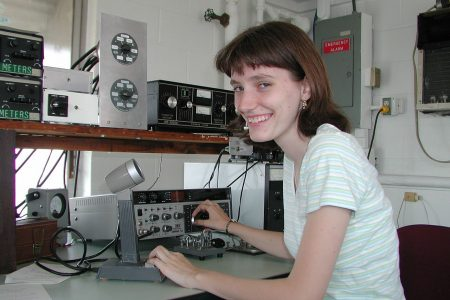 Amateur 'ham' radio operator, Yvette Cendes, KB3HTS, at station W8EDU, 2005. Photo by Andromeda321 at en.wikipedia (Yvette Cendes) (CC3)
