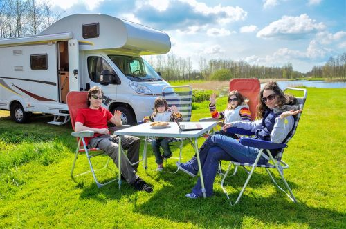 Family camping in a motorhome