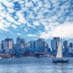 Sailboat against the Seattle skyline photo by cascoly - DepositPhotos.com