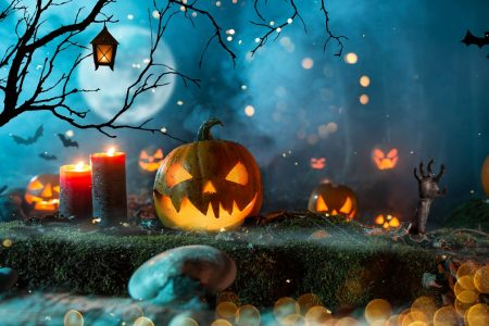 Halloween pumpkins in a spooky forest photo by Kesu01 - DepositPhotos.com