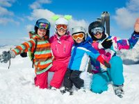 Family enjoying winter snow sports photo by mac_sim - DepositPhotos.com