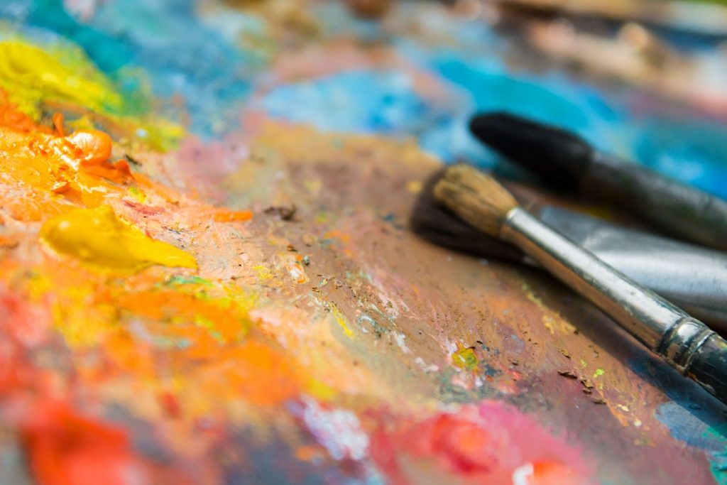 Oil paints and paint brushes on a palette photo by VBaleha - DepositPhotos.com