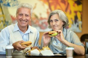 Senior couple enjoying fast food meal photo by aletia - Depositphotos.com