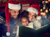 Family reading Christmas book together