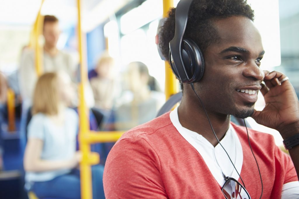 Listening to podcasts on the bus