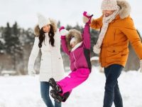 family walking on snowy day
