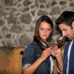 A couple wine tasting at a winery - DepositPhotos.com