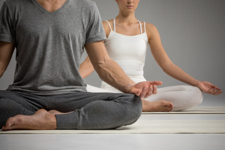 Man and woman in yoga pose - DepositPhotos.com