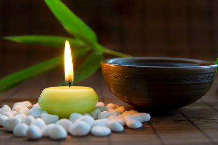 Candles, tea, and zen stones create harmony for meditation practice - DepositPhotos.com