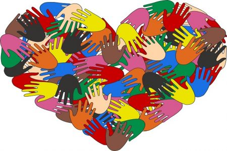 Depositphotos_8465575_l-2015 many hands on a heart