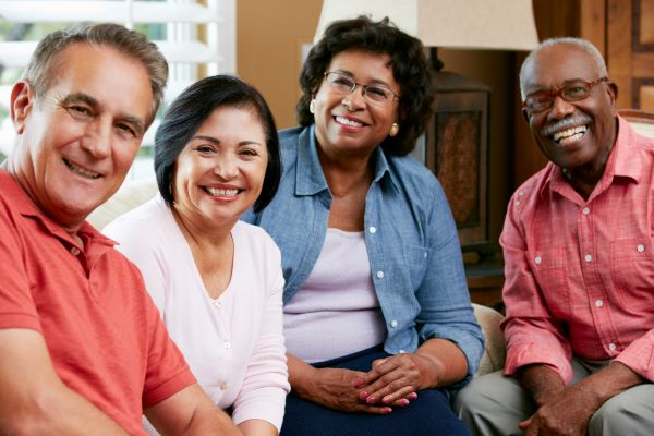 Group of senior citizens socializing together