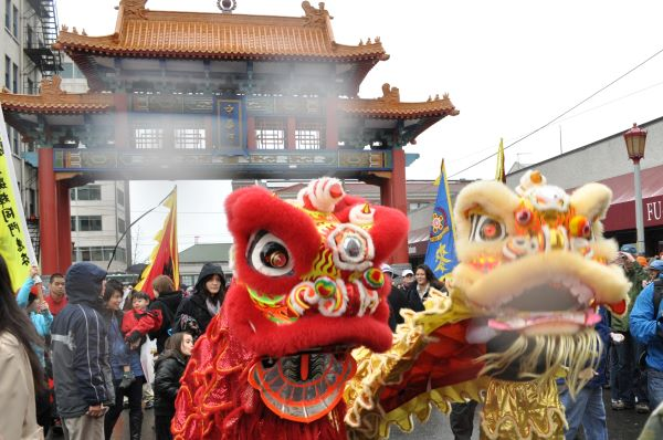 Lion dancers at Historic Chinatown Gate in Seattle, WA for Chinese New Year 2011 Photo by Joe Mabel (CC3)