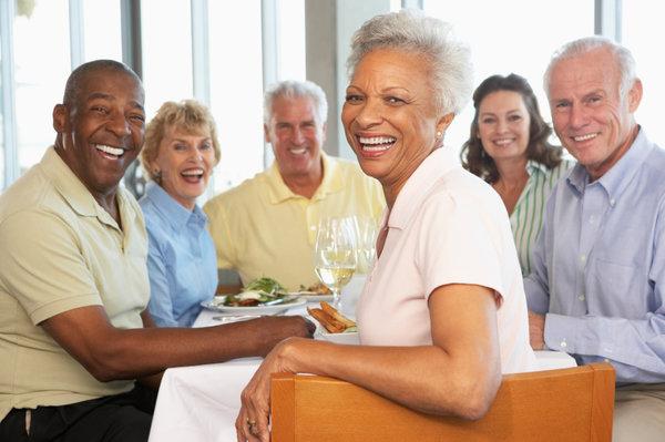 Group of senior citizens enjoying a restaurant meal