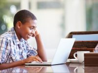 Young boy enjoying a computer session at home