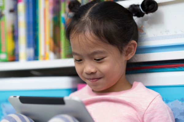young girl reading an ebook