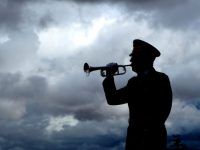 bugle player playing taps