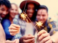 Groups of friends celebrating with sparklers