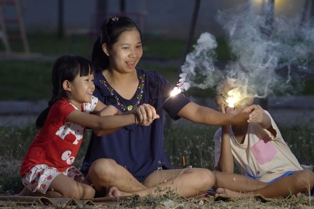 Family celebrating with sparklers