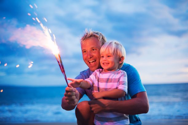 Father and son with fireworks