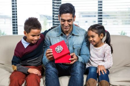 kids giving father a gift