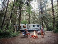 RVshare family around campfire